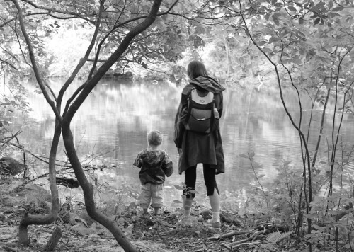 This slightly soft shot of my wife and son pondering the pond's beauty works much better in black and white.