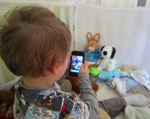 """""""Say Cheese!"""" My son works the moment in his crib photographing his favorite animals!"""