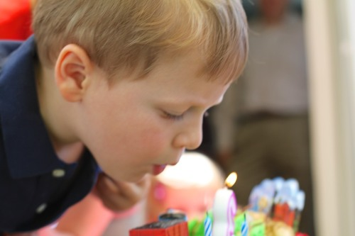 I captured the moment that defined my son's third birthday.  But there were 43 more seconds of video action I was hoping someone in the crowd would get.  The next gauntlet would be to convert the video from QuickTime to Windows Media.  More cake, anyone?