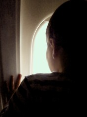 The view from 30,000 feet isn't the only distraction for a three year old. Technology in flight has its own lure…