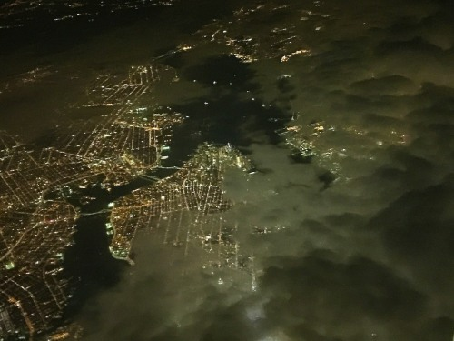 Simply pointed out of my descending plane's window, the camera on my iPhone 6 Plus was able to capture this cool nighttime moment over Manhattan as we broke through the clouds.