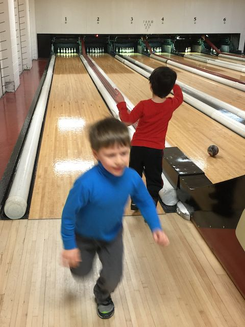 Why is everything crystal clear in this picture except for my son?  The problem is my young bowler is the only part of the image moving quickly!  A faster camera lens could have frozen this action shot.