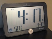 """You're probably wondering, """"What's a Bluetooth clock?"""" Heck, I'm sure some of you are asking why would anyone even need a clock on a desk anymore. But hold on… The trick is this clock can connect to your smartphone…"""